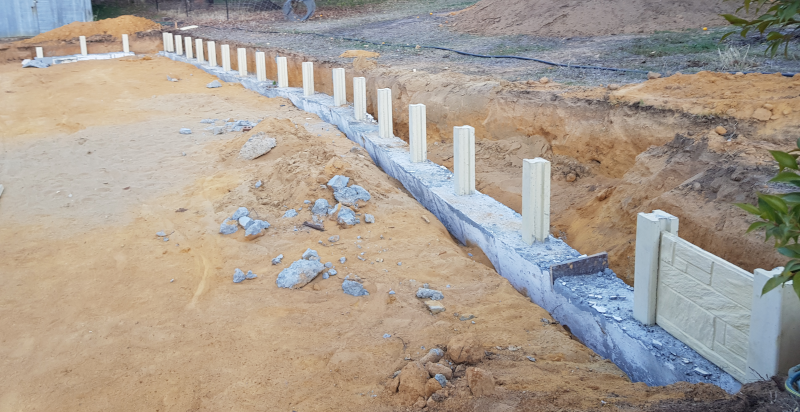 House retaining wall – pour and un-forming